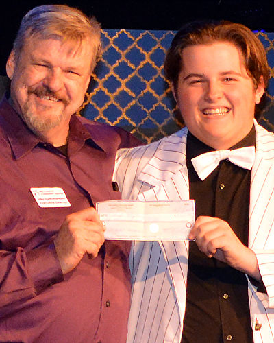 "Mike Rademaekers prises Charles McLean by awarding him $1,000.00 from HCCT's Phil Holbert Scholarship fund before the opening curtain of ""Dirty Rotten Scoundrels"" on Friday, July 26."